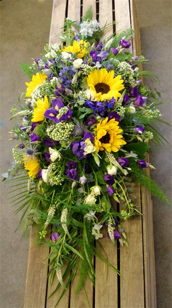Sunflower and purple casket spray funeral flowers tavistock